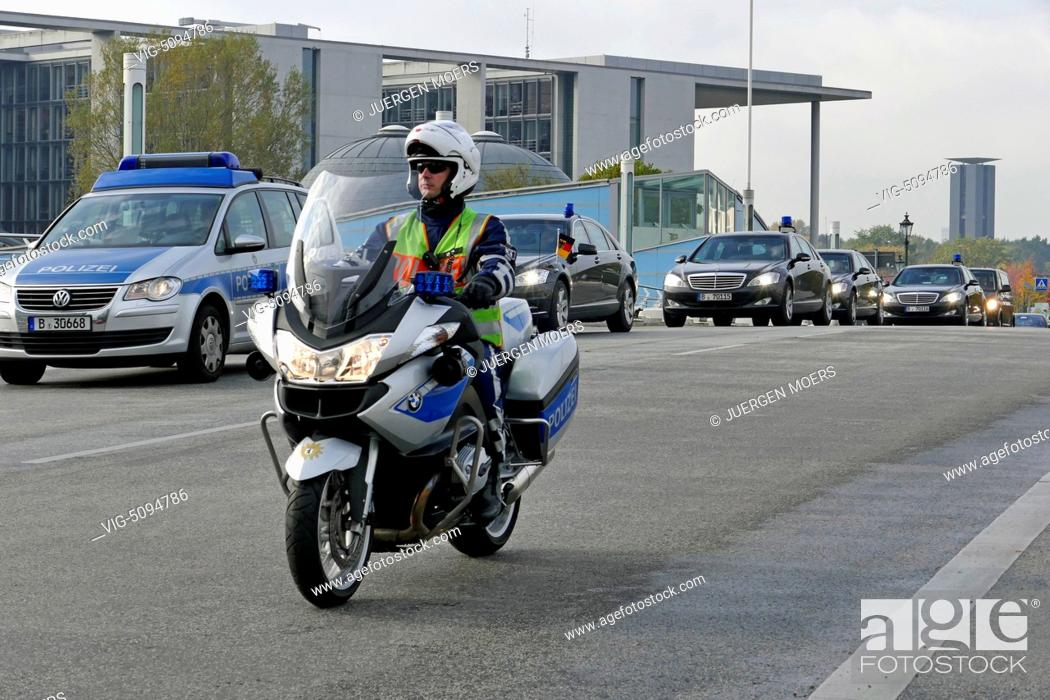 Stock Photo  Germany Berlin Police Escorts During The Visit Of The French Foreign Minister Laurent Fabius At Frank Walter Steinmeier