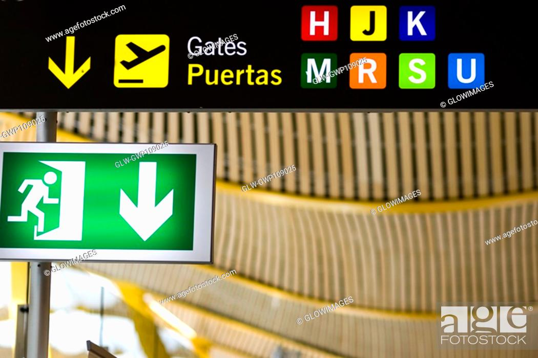 Stock Photo: Close-up of an emergency exit sign at an airport, Madrid, Spain.