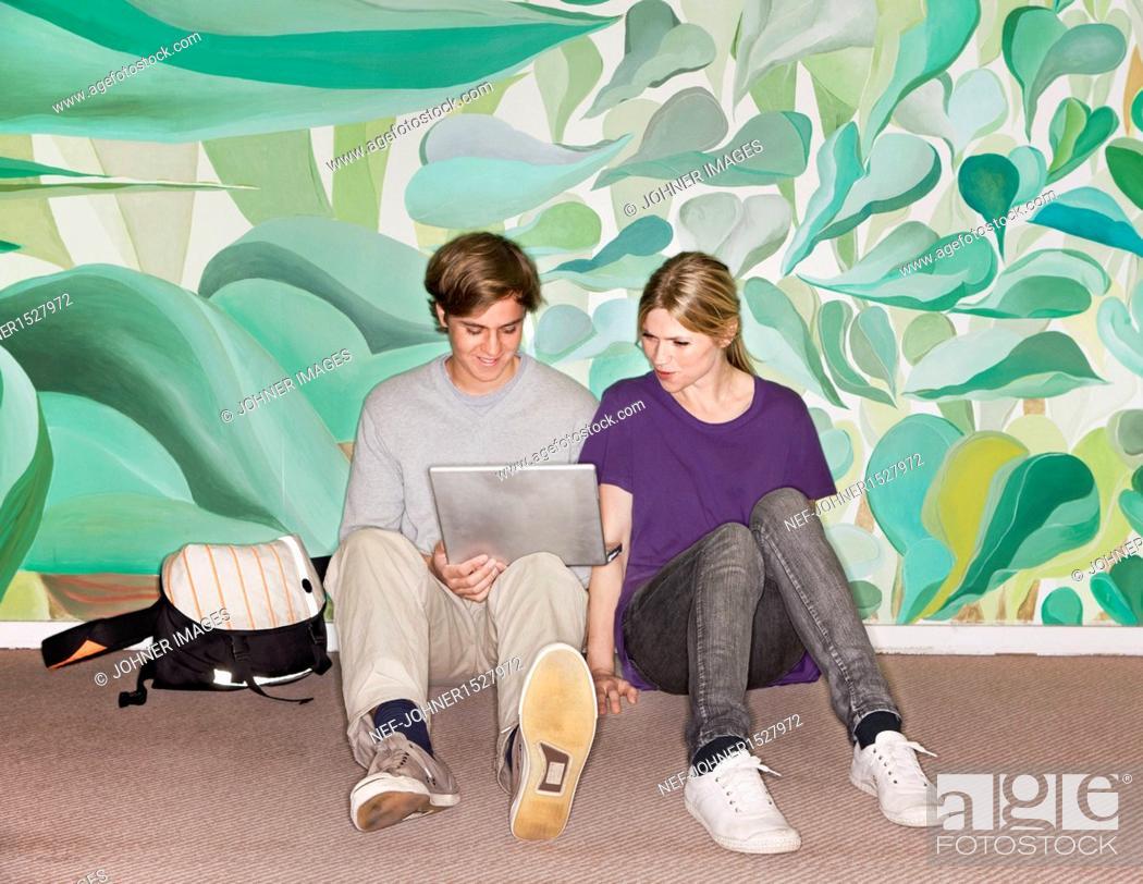 Stock Photo: Students using laptop.