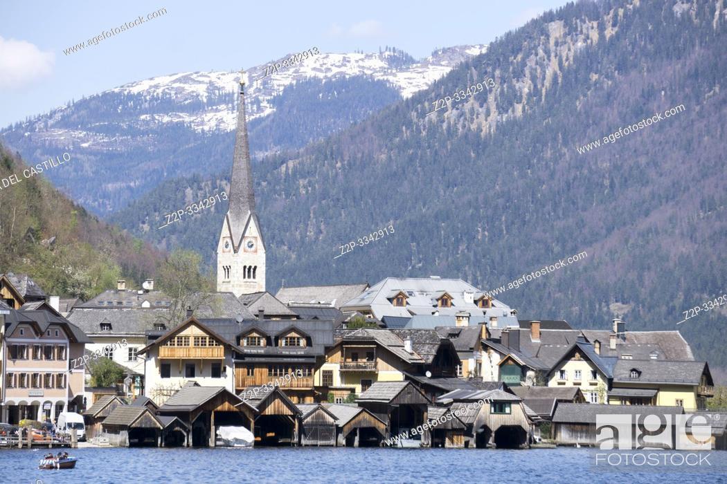 Stock Photo: Hallstatt village and lake in Salzkammergut, Austria on April 19, 2019.