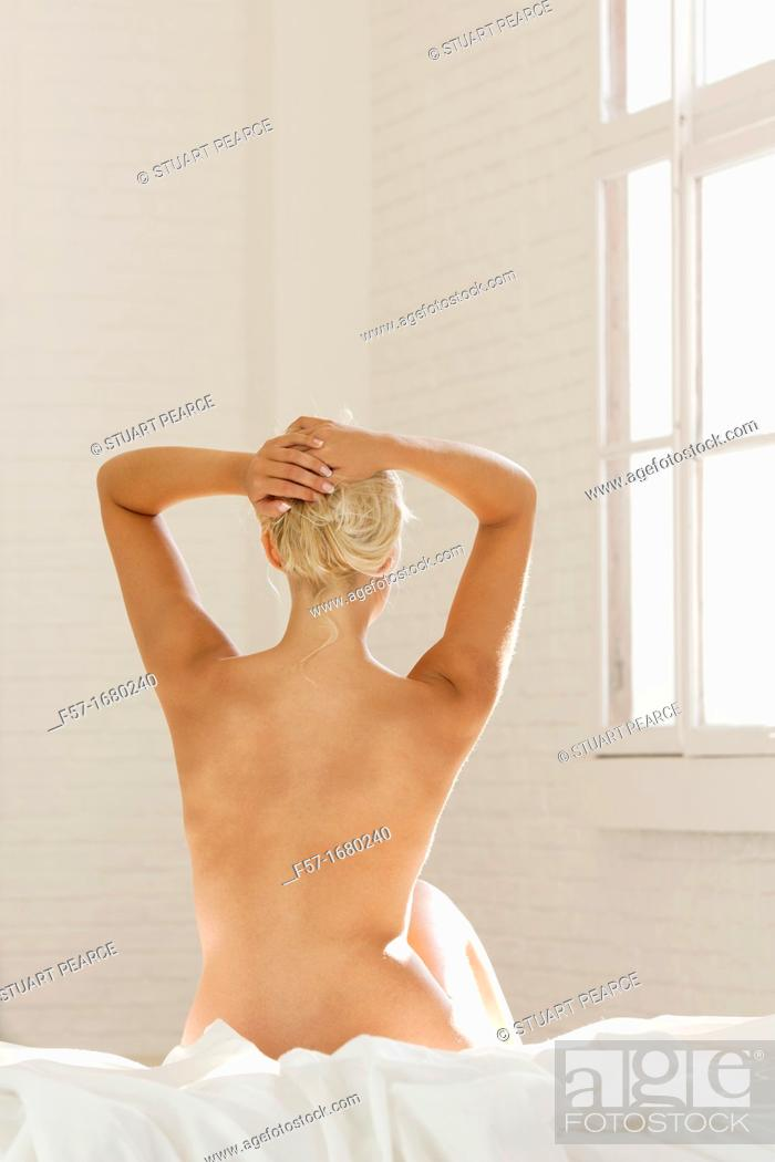 Stock Photo: Naked female in bed.