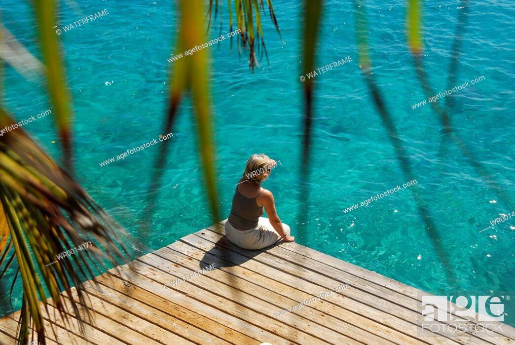 Stock Photo: Woman at Jetty, Caribbean Sea, Netherland Antilles, Curacao.
