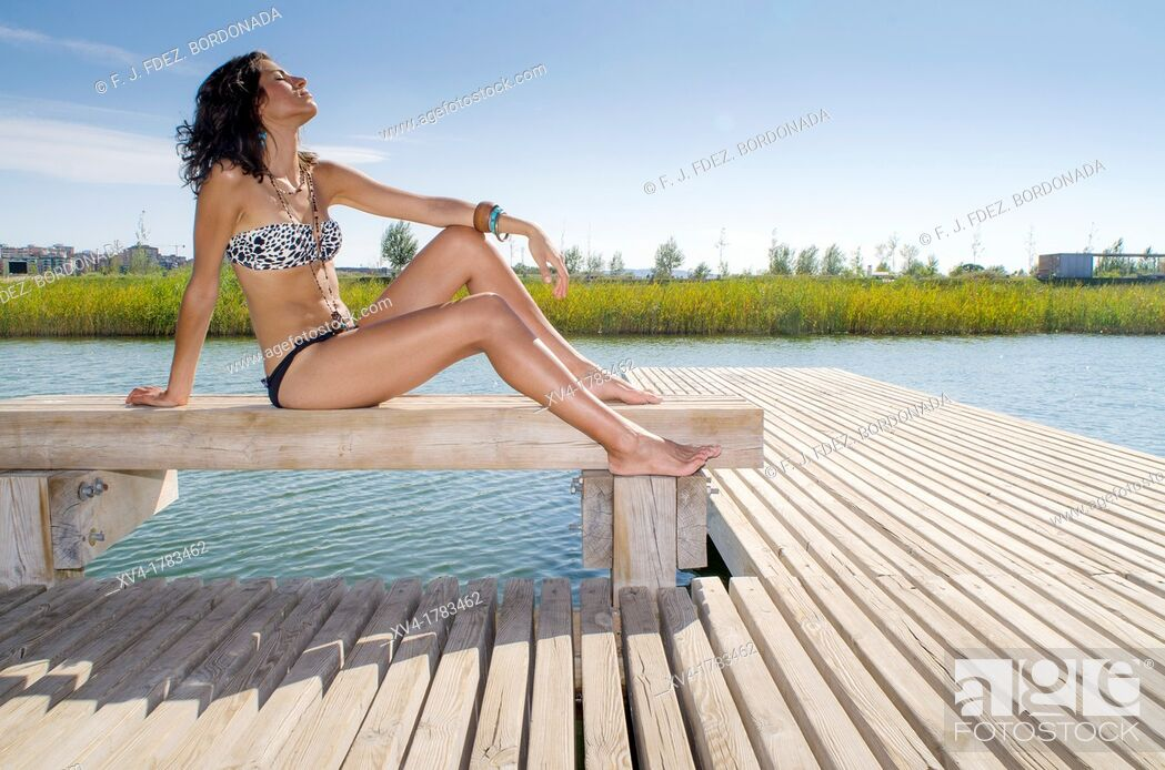 Stock Photo: Young girl relaxed with bikini at lake in summertime.