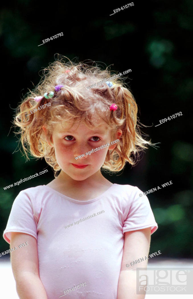 Stock Photo: little girl with many short pigtails, in pink leotard.