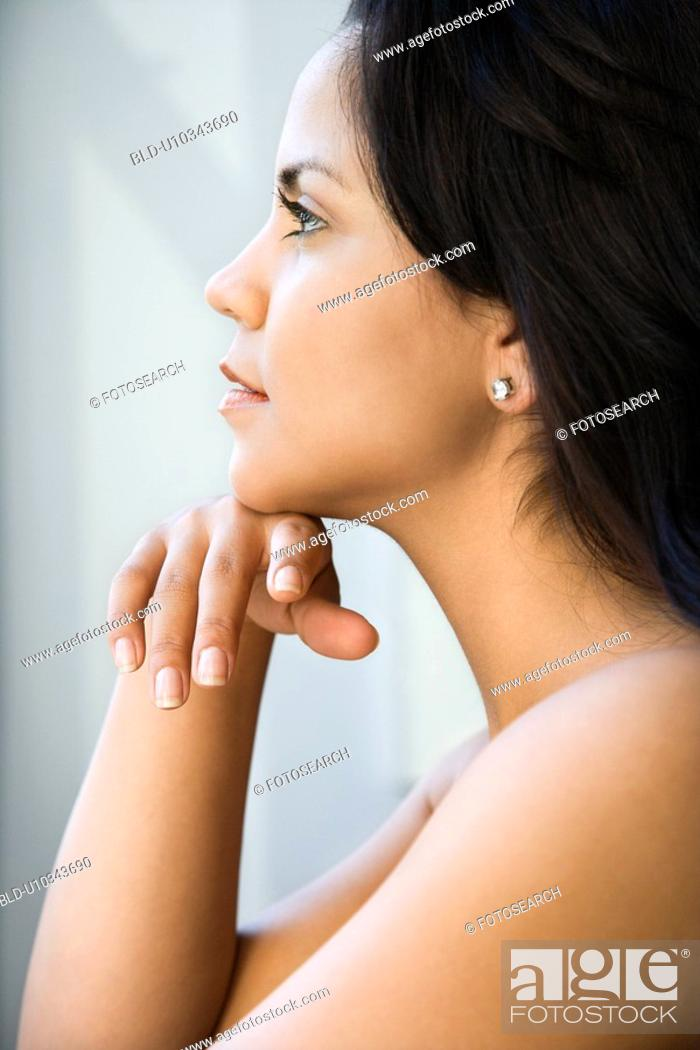 Stock Photo: Woman with head on hand.