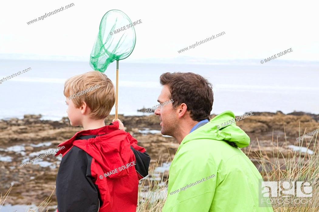 Stock Photo: Father and son with fishing net.