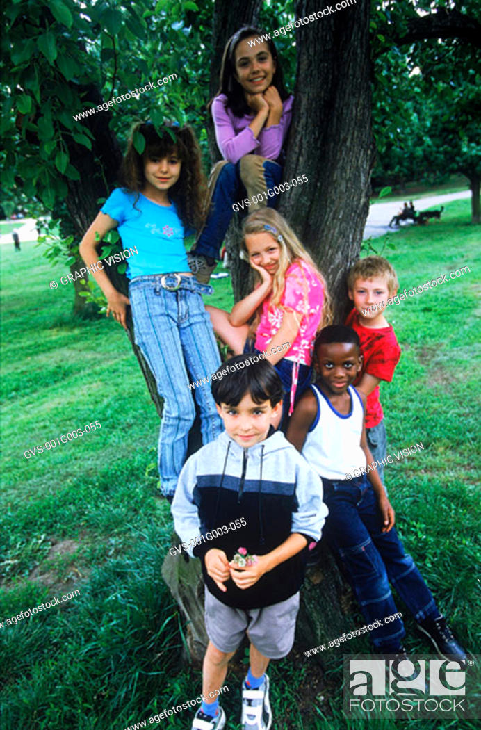 Stock Photo: Young children at a tree in the park.