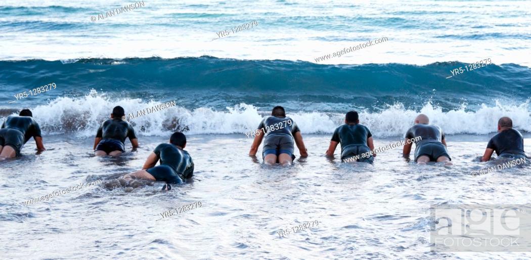 Stock Photo: Spanish soldiers doing press ups in sea  Playa de Las Canteras, Las Palmas, Gran Canaria, Canary Islands, Spain.