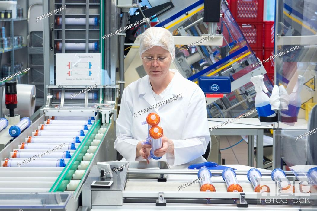A production assistant in a production lab of the medical technology