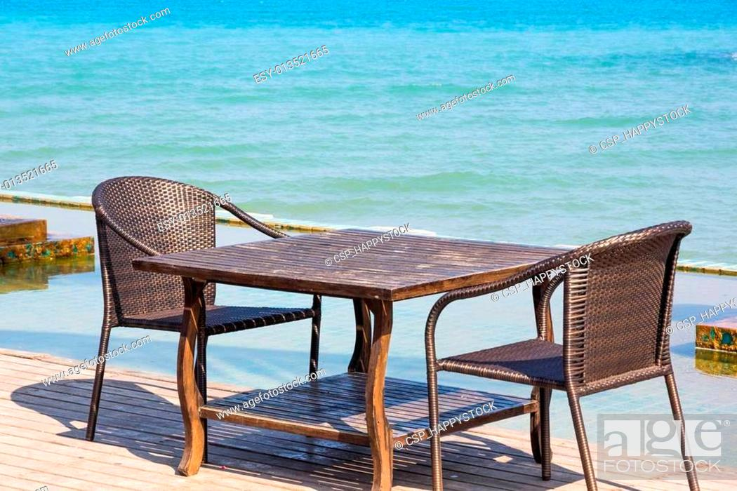 Stock Photo: Table chair beside sea.