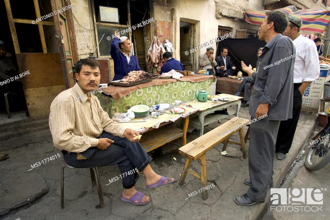 Stock Photo: People in a street restaurant in Kashgar downtown  Kashgar city  Xinjiang province  China  Asia.