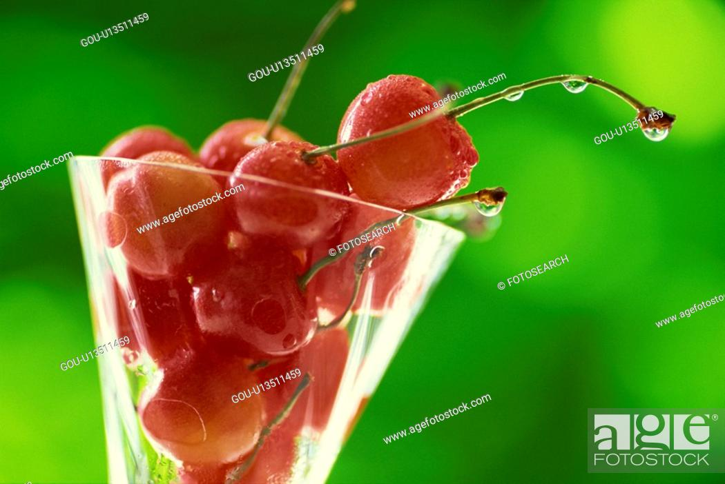 Stock Photo: The Cherry In A Glass.