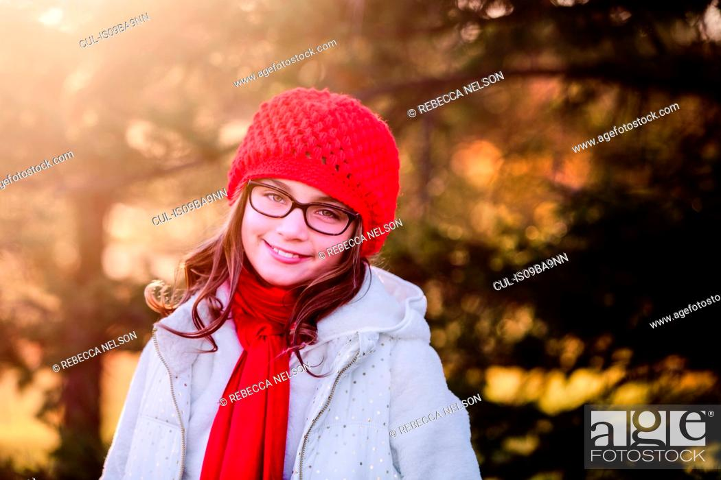 Stock Photo: Portrait of girl, outdoors, smiling.