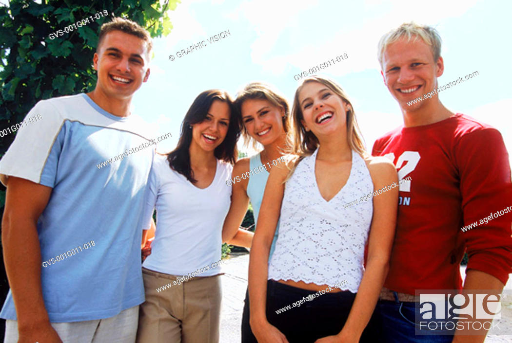 Stock Photo: Portrait of a young group of people standing together.