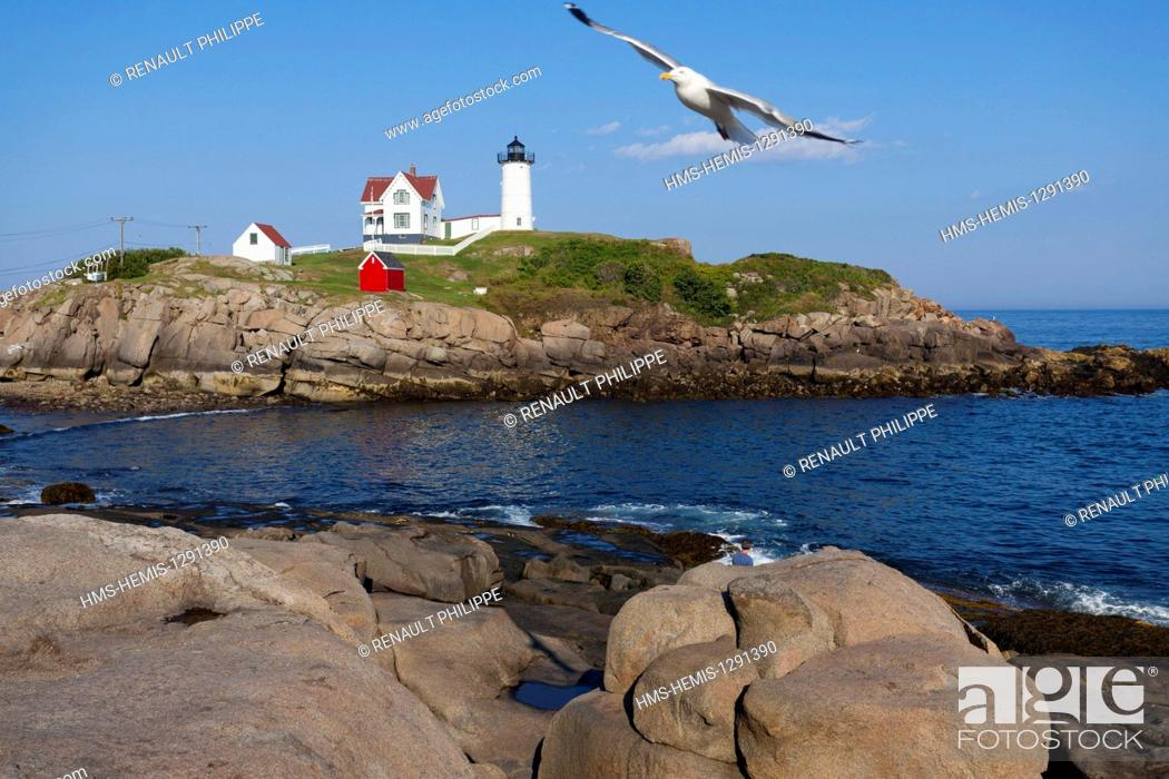 Stock Photo: United States, Maine, York, Cape Neddick, Nubble Lighthouse located on an island near the coast.