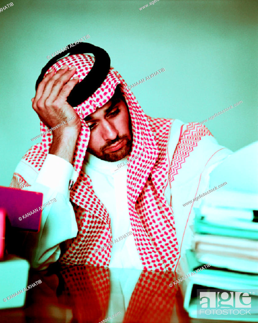 Stock Photo: Desperate Arab businessman at his desk.