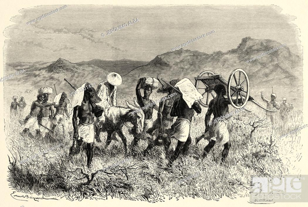 Stock Photo: Shaw on a mule while natives carry supplies and belongings, travel and exploration by Henry Morton Stanley, expedition how I found Livingstone in Central Africa.