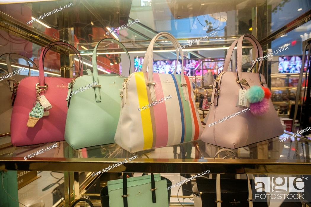 Stock Photo - Spring colored handbags on display at the Kate Spade boutique within Macy's in New York.