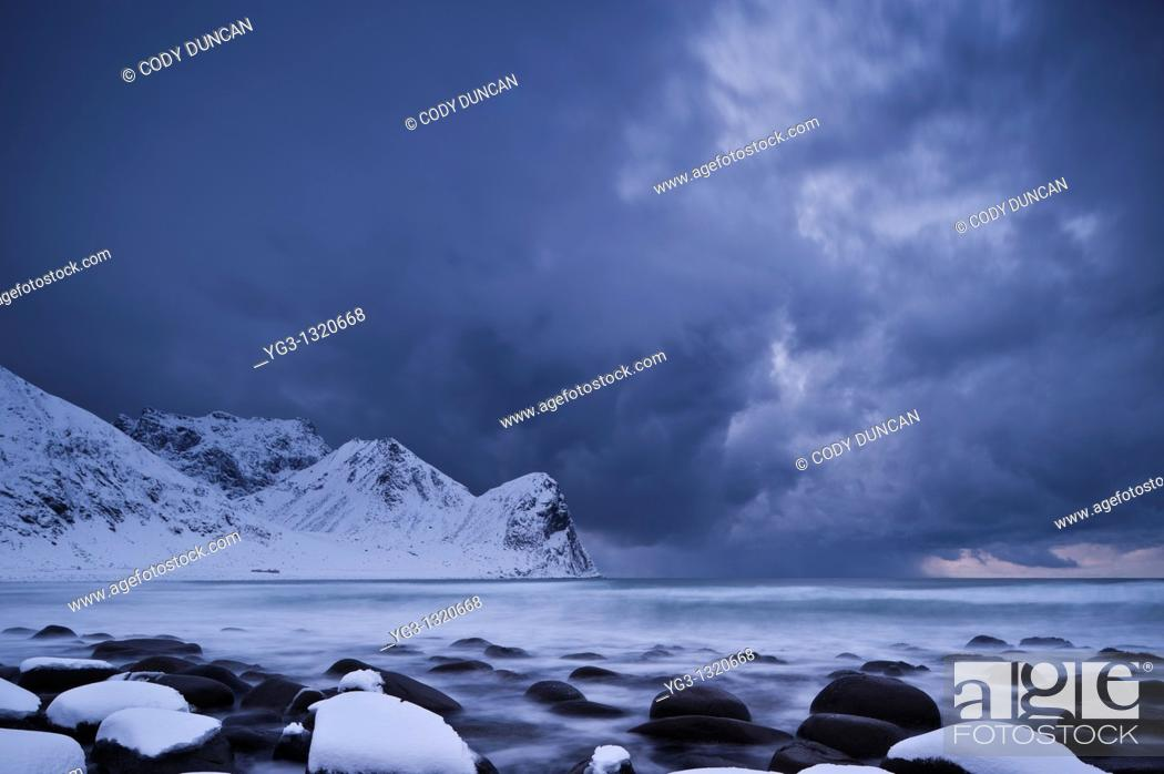 Stock Photo: Winter storm over snow covered beach, Unstad, Lofoten islands, Norway.