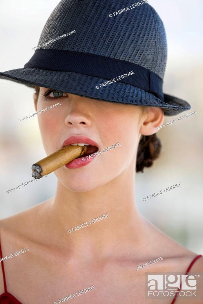 Stock Photo: Fashion model smoking a cigar.