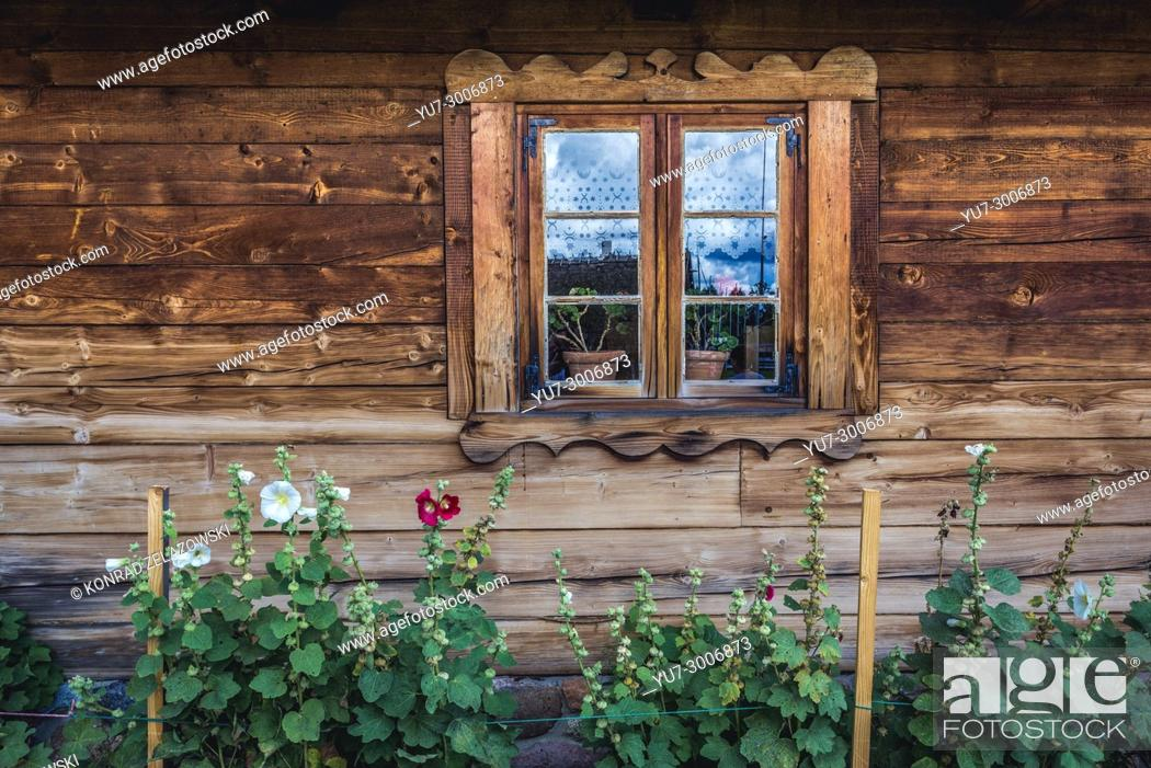 Stock Photo: Wooden cottage in Museum of Folk Culture in Wegorzewo town, Warmian-Masurian Voivodeship of Poland.