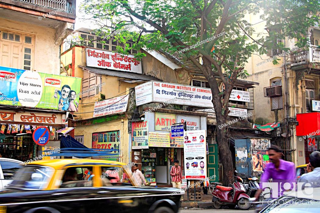 Stock Photo: Old building mass urban housing and the girgaon institute of commerce coaching class ; Charni road ; Bombay Mumbai ; Maharashtra ; India.