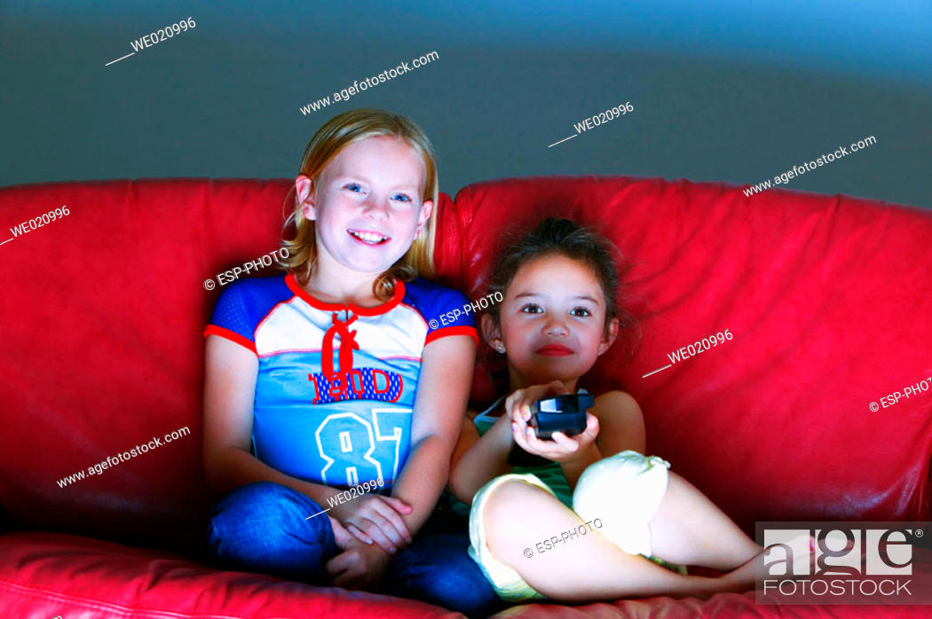 Stock Photo: Young girls watching television.