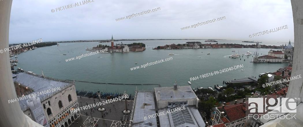 Stock Photo: 12 May 2019, Italy, Venedig: Wide angle: Southern view from Campanile. From the Markusturm clouds lie over the city of Venice.