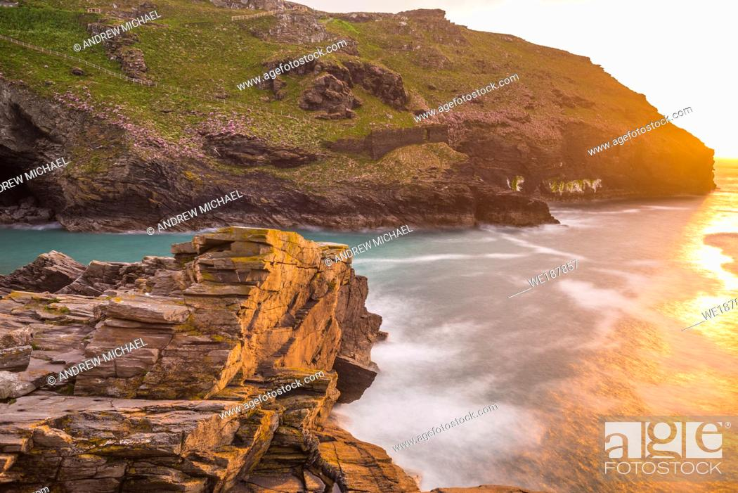 Stock Photo: The ruins of Tintagel Castle on Tintagel Island at sunset, a site linked with the legend of King Arthur, Cornwall, England, UK.