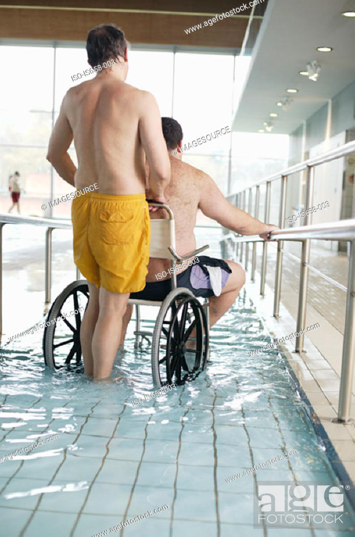 Stock Photo: Two men entering swimming pool.