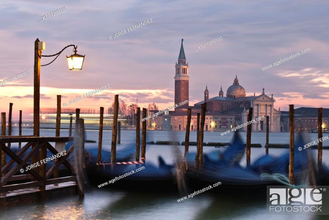 Stock Photo: View of Lido island and gondolas at sunrise, Venice, Italy, Europe.