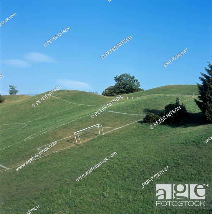 Stock Photo: Playing field on a hill.