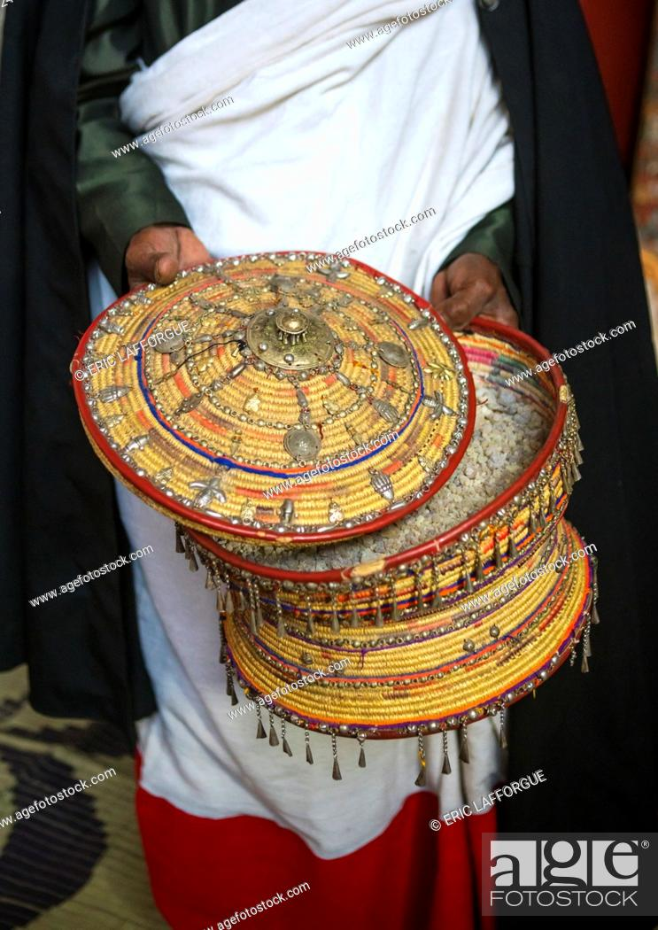 Stock Photo: Ethiopia, Amhara Region, Lalibela, ethiopian orthodox priest with an insence basket in nakuto lab rock church.
