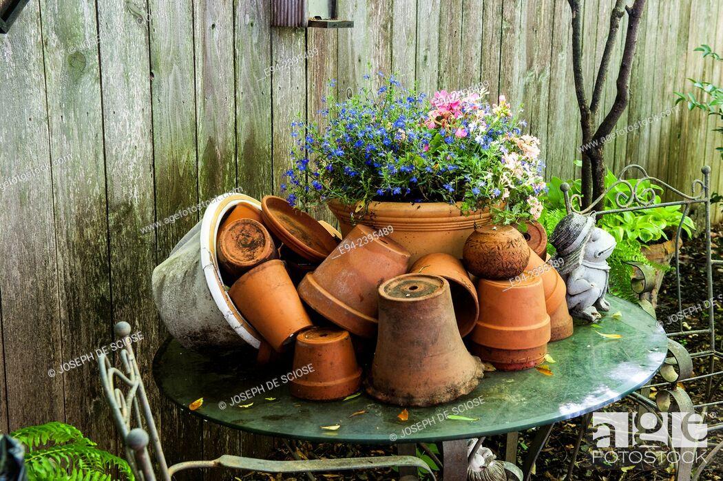 Stock Photo: Table with terra-cotta pots in a garden setting.Georgia USA.