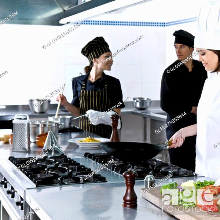 Stock Photo: Chefs cooking food in the kitchen.