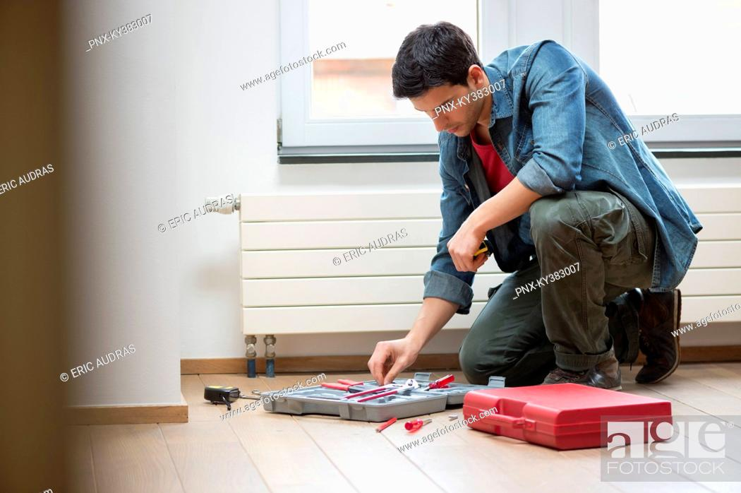 Stock Photo: Technician arranging his toolbox.