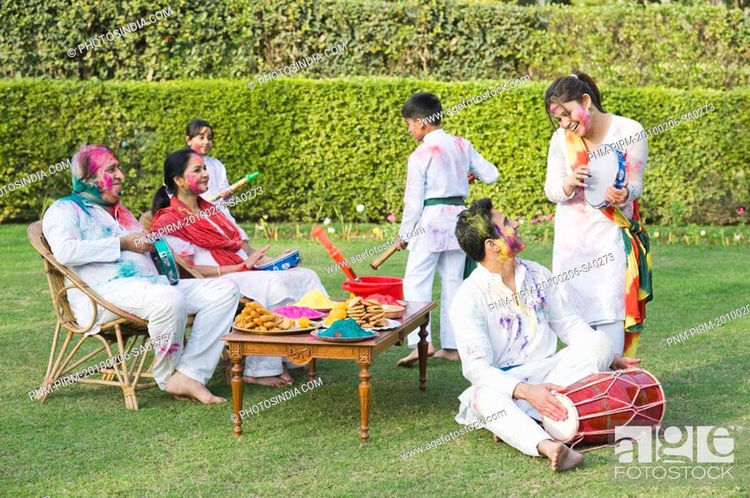 Stock Photo: Family celebrating Holi.