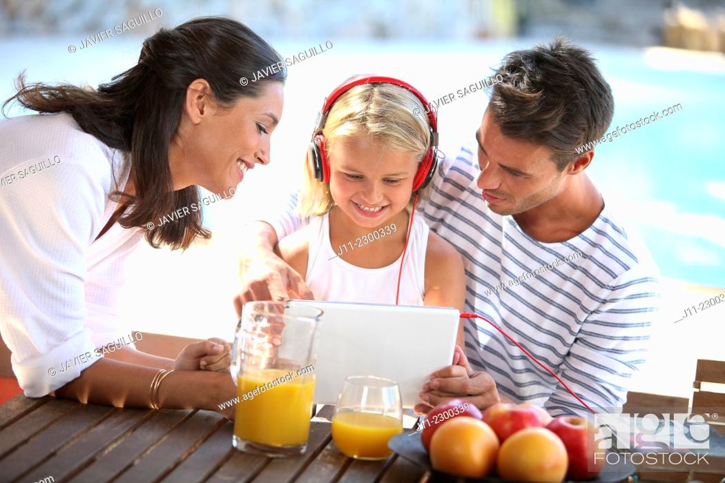 Stock Photo: Family, girl with digital tablet and headphones.