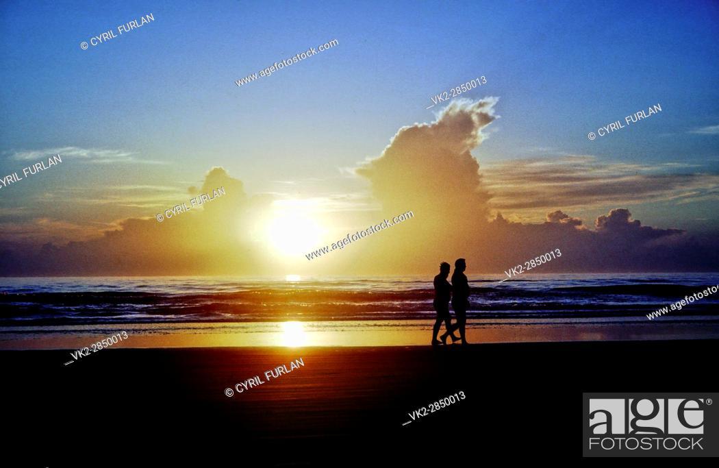 Stock Photo: Sunrise Walk Along Sea Shore,.
