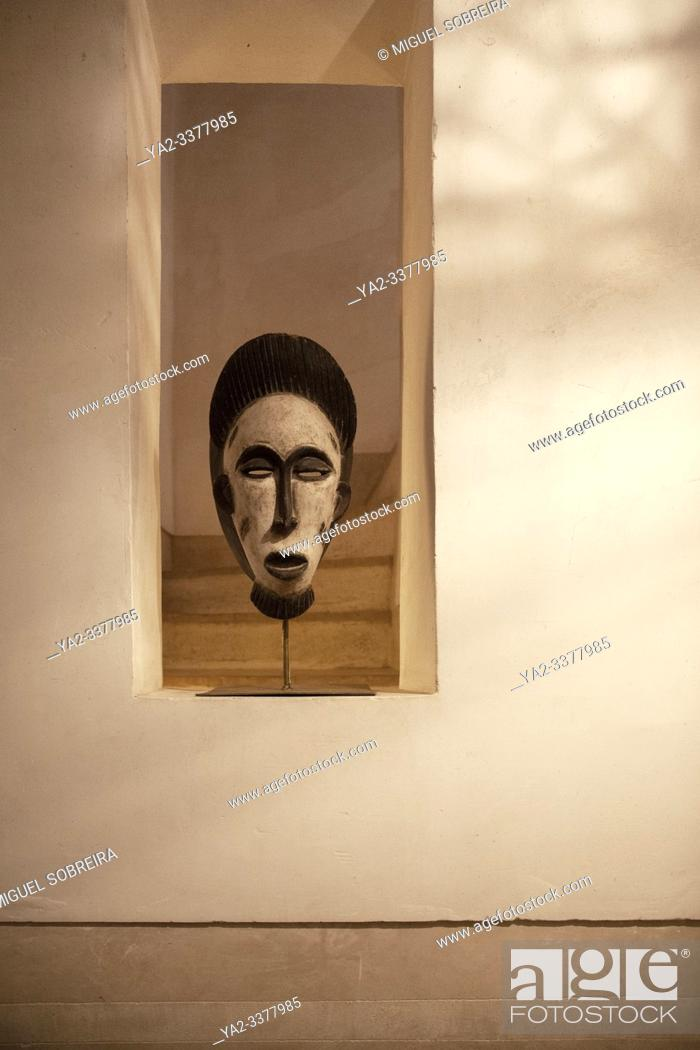 Stock Photo: African Mask in Alcove.