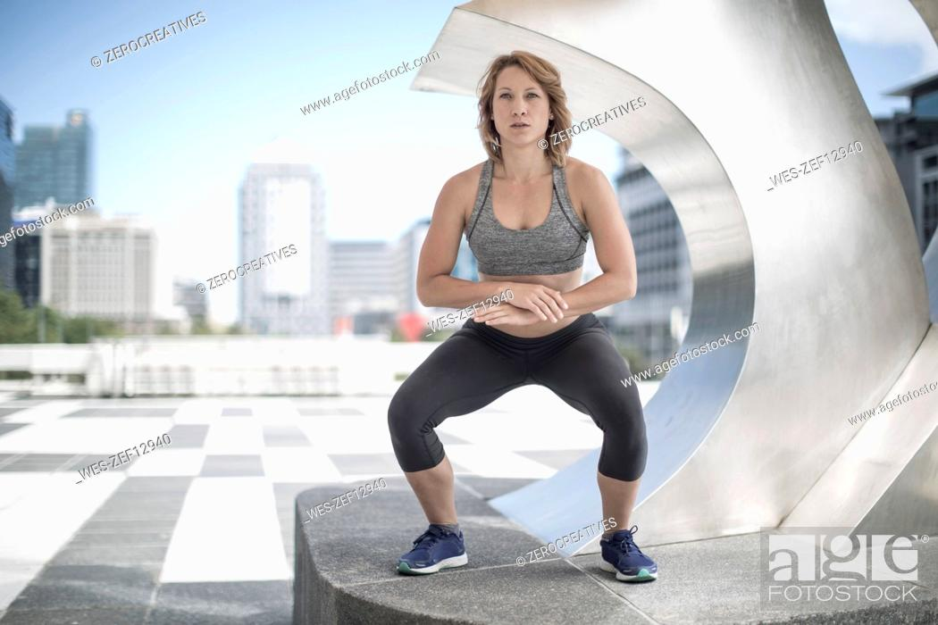Stock Photo: Young woman exercising in the city.