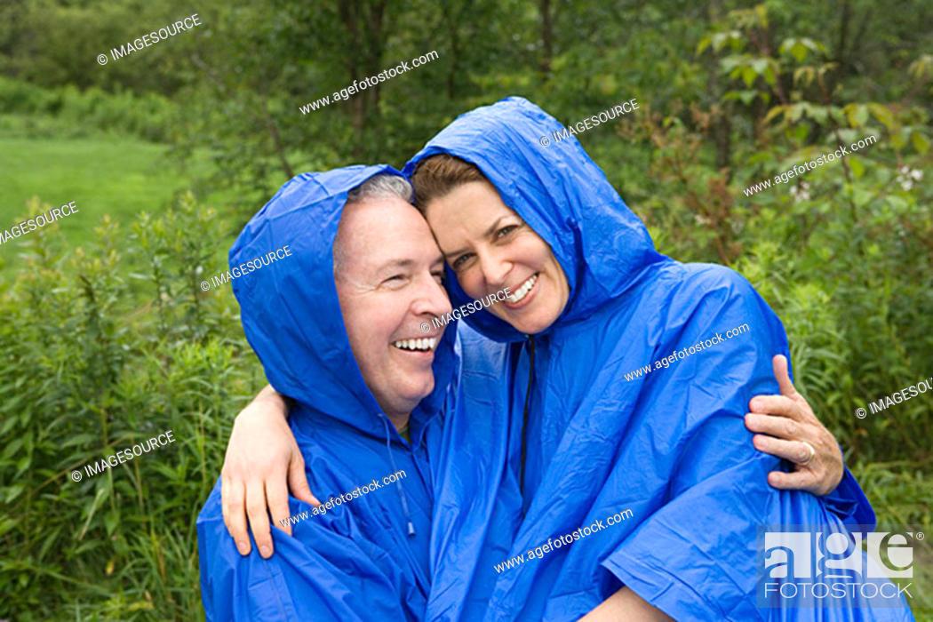 Stock Photo: Mature couple wearing raincoats.