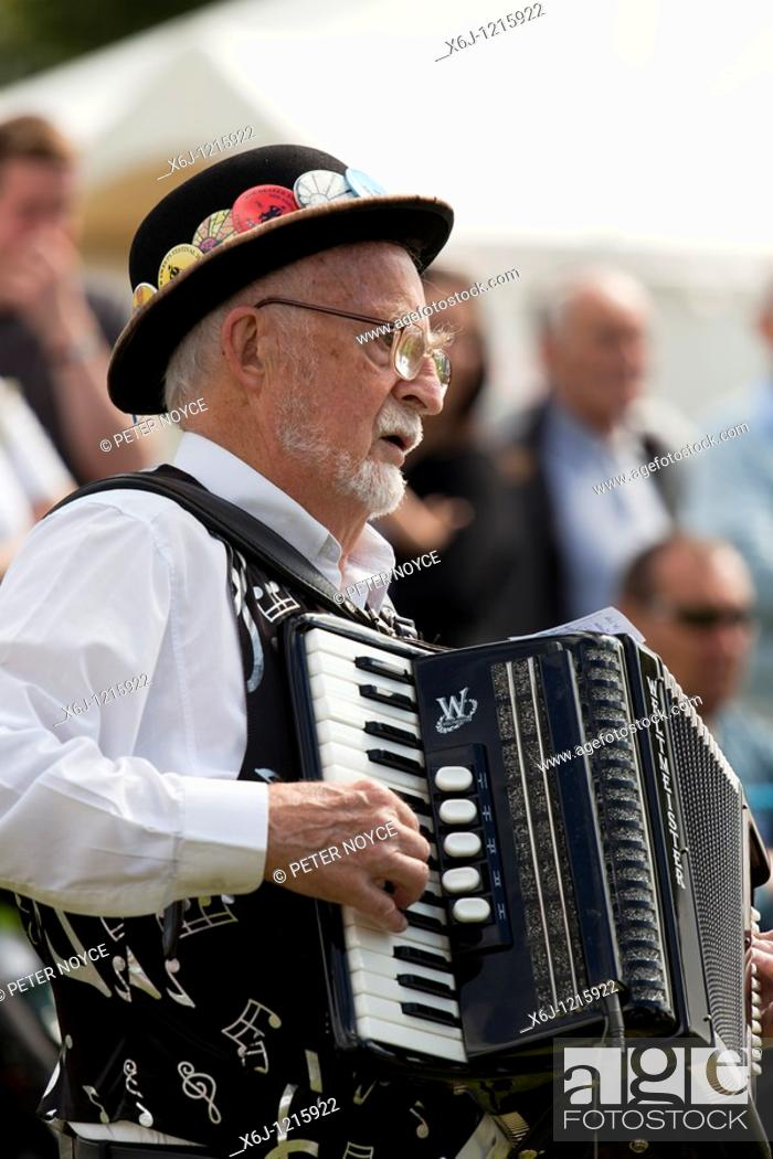 Stock Photo: traditional step dancing demonstration with violin and accordian players.