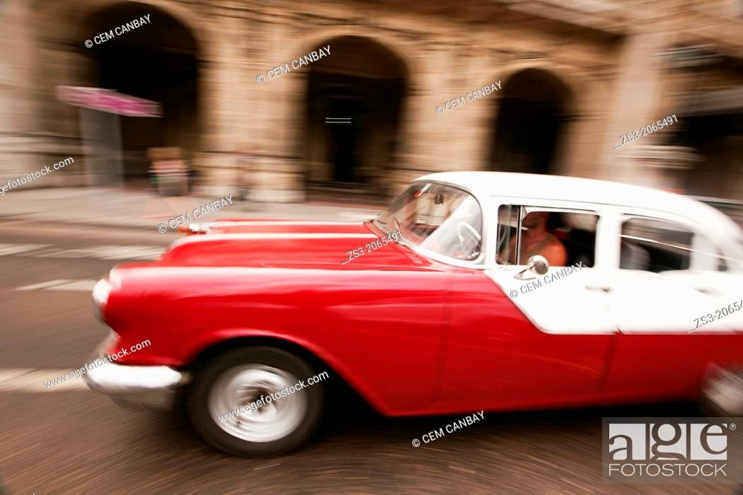 Stock Photo: Dynamic scene of an old american car, Prado, Havana, Cuba, West Indies, Central America.