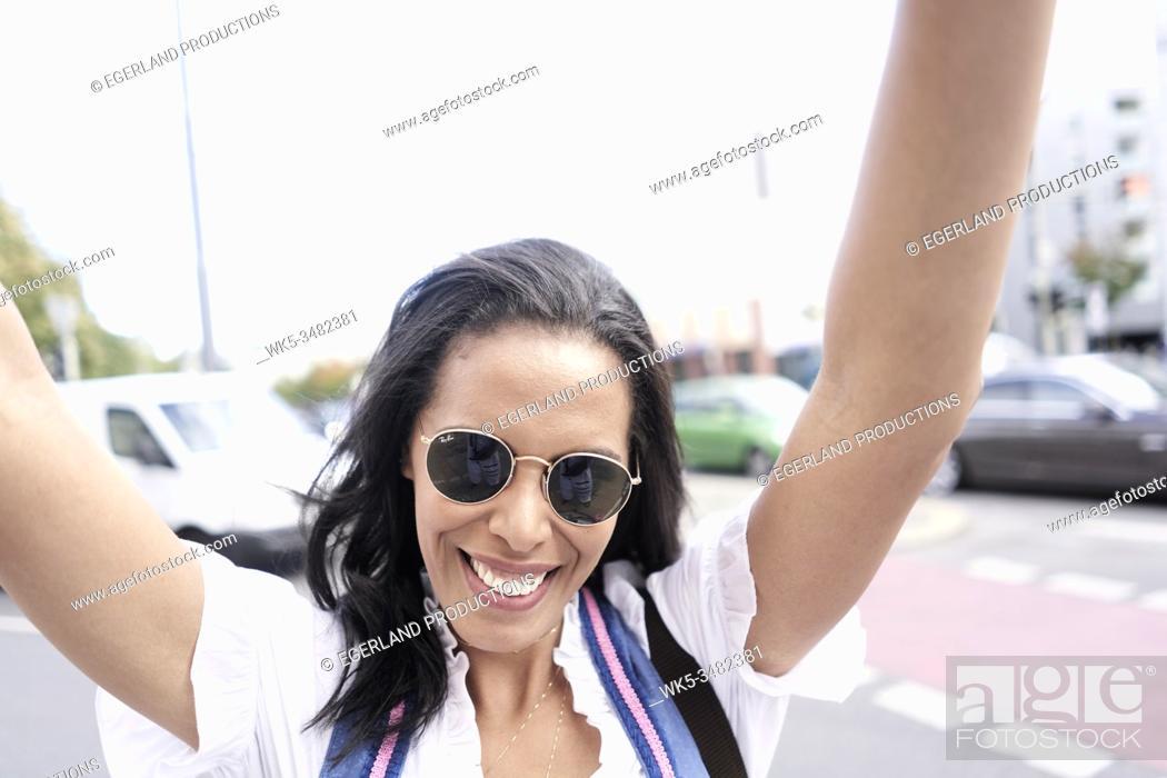 Stock Photo: Brazilian woman wearing Dirndl, Munich, Germany.