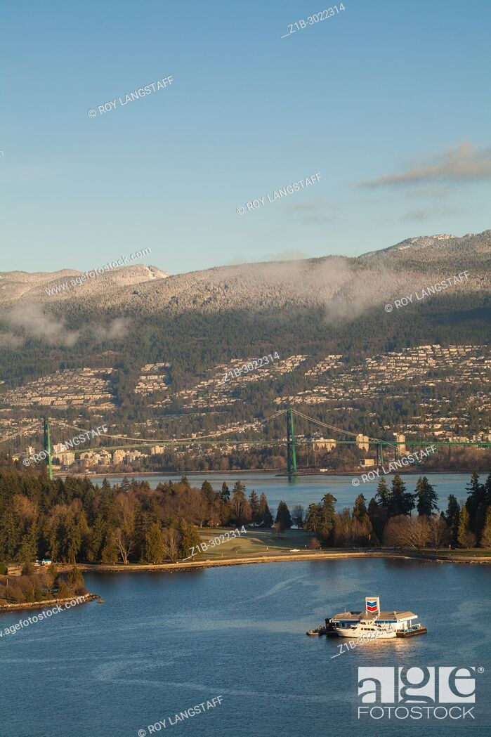 Stock Photo: Lions Gate Bridge with Stanley Park in the foreground, Vancouver, British Columbia. Canada.