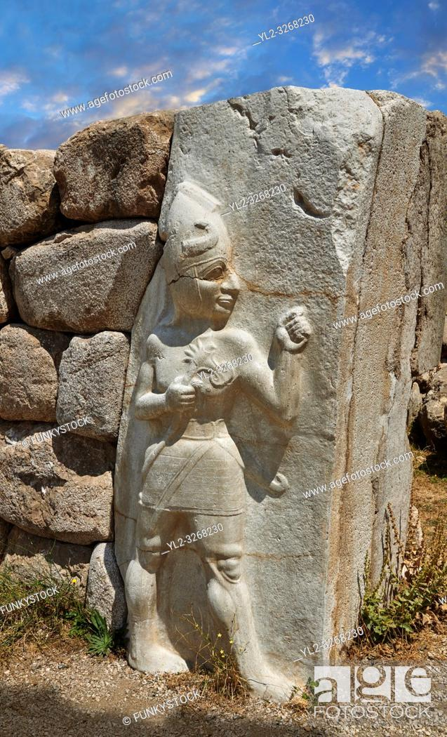Stock Photo: Picture & image of the Hittite Relief sculpture of the God of War of the Kings Gate. Hattusa (or Hattusas) late Anatolian Bronze Age capital of the Hittite.