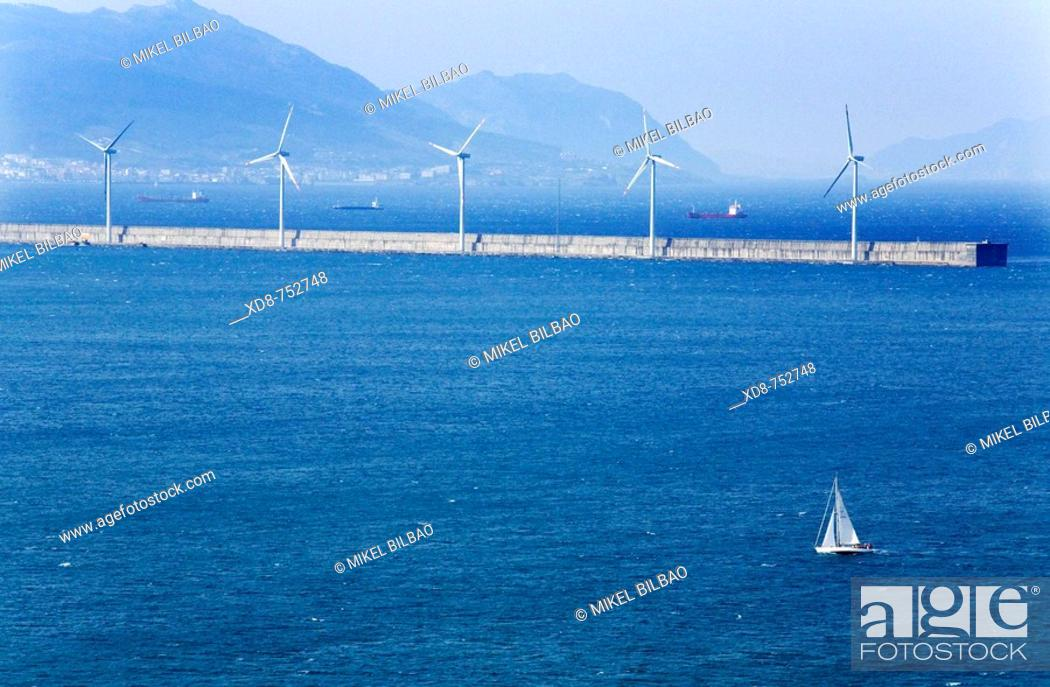 Stock Photo: sailboat sailing in the Abra, and breakwater with wind turbines, near Bilbao  Biscay  Biscayan coast  Basque Country  Spain.