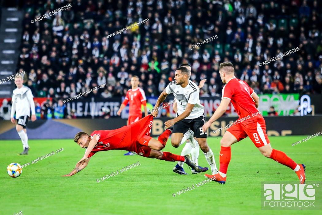Stock Photo: Wolfsburg, Germany, March 20, 2019: footballers Jonathan Tah (GER) and Sergej Milinkovic (SRB) in action during the international soccer game Germany vs Serbia.