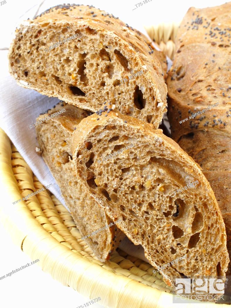 Stock Photo: Slices of rye with poppy seeds.